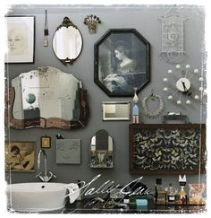 awesome wall arrangement of vintage mirrors & jewelry
