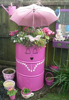 Use old drum for planter, and what a lot of fun making it :)