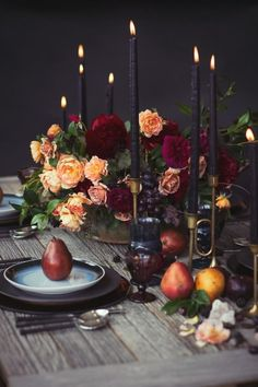 dark rich luxurious table decor with candles and pears