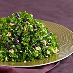 Kale Salad with Preserved Lemon & Walnuts Recipe with garlic, salt, extra-virgin olive oil, lemon juice, dried oregano, freshly ground pepper, kale, toasted walnuts, pitted kalamata olives, lemon rind