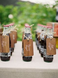 soda escort cards #wedding #country - what if we did this with the cards attached to glasses of champagne?