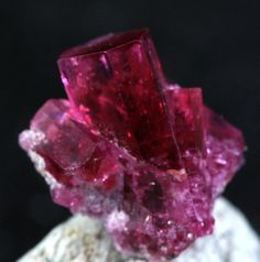 Red Beryl from Utah. Also known as bixbite or red emerald, it is the rarest form of beryl of all.