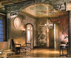 Impressive! The ceiling mural was painted on movie-poster paper covered in plexi-glass; the patina on the walls combine layers of tinted and textured plaster.