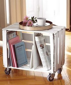 Clever, cute and cheap DIY bookshelf/sidetable on wheels. <3 adorable ! Would be cute to pull out as eating trays if eating in the living room!