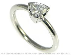 Stunning trillion cut 0.54ct diamond engagement ring from our ready to wear collection, designed by Jenna Lawson