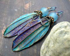 A Flash of Blue Sky - wearable art polymer clay aqua midnight blue bronze lampwork rustic leaf earrings.