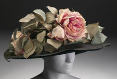 1908 fascinator... I may be able to pull something like this off with a big floppy hat from the thrift store.