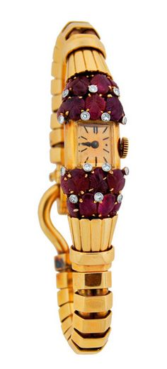 Van Cleef & Arpels Lady's Yellow Gold, Ruby and Diamond Retro Bracelet Watch, Fabulous lady's Retro bracelet watch created by Van Cleef & Arpels in the 1940s. Features carved rubies accented with diamonds set in yellow gold.