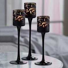 $25 - for set of three. Retail $60.  Forbidden Fruits - Vine Tealight Trio holds tealights and adds sexy to any room!