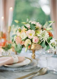 Some of the tables will have a gold compote vase filled with cream hydrangeas, blush spray roses, coral peonies, peach tulips and pale green succulents surrounded by low gold votives