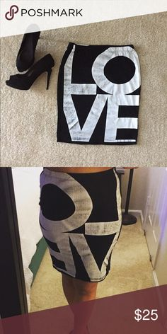 "Fall in Love with this Love Skirt! 💗 Fall in love with this ""love"" skirt. Only wore this once, still like new! This cute skirt can be worn dressed up or down. Love pattern on back of skirt as well. Looks great with a denim top too. Shoes used for prop only, not for sale. Size Medium. Measurements: 20"" long x 13"" waist Elastic waist with a stretch to the skirt. 97% Cotton and 3% spandex. Skirts Pencil"
