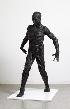"Artist: Yong Ho Ji.  Work: ""Man"" .  Made with Recycled Tires"