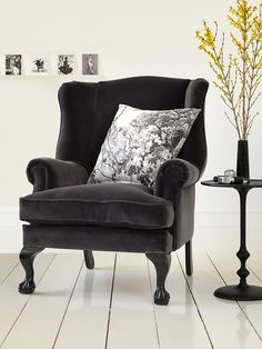 Georgian Wing Back chair by Delcor. Black velvet armchair