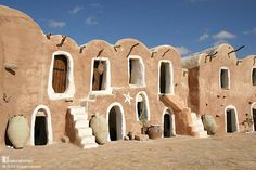 These are the vaulted adobe homes of the 15th century Ksar Ouled Debbab. The homes were built alongside similar but usually taller granaries called ghorfa. The whole complex was a fortified settlement with only one entrance. Ksar Ouled Debbab is in the Tataouine district of southern Tunisia. Follow the picture back to www.naturalhomes.org for more.