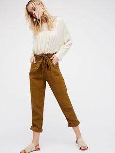 Like This Paper Bag Pant   Lightweight linen paper bag style pants.    * Button fly.   * Four-pocket style.   * Adjustable tie belt.   * Cropped inseam.   * Cuffed hem.