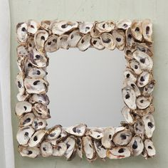 oyster shell mirror.... different than the traditional driftwood mirror.
