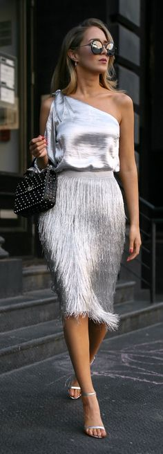 Click for outfit details! One shoulder metallic blouse, metallic fringed midi skirt, studded black leather shoulder bag, round sunglasses and silver ankle-strap sandals {Valentino, Rachel Zoe, Rebecca Minkoff, Sunday Somewhere, Sam Edelman, fall trends, fall winter trends 2017, fashion trends, classy dressing, statement dressing, fringe, metallic}