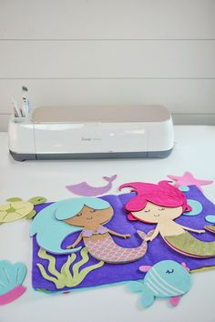 Felt Mermaid Quiet Book Tutorial Cricut Maker The New Cricut Maker Cutting Machine Felt Mermaid Quiet Busy Book SVG Free Tutorial Quiet Book Patterns, Sewing Patterns For Kids, Sewing Projects For Kids, Sewing For Kids, Art Projects, Sewing Ideas, Quiet Book Templates, Felt Patterns, Vinyl Projects