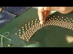 In This Video You Can Watch Making Of Beautiful zardozi spring embroidery Work, French knots with sequins and Beads Embroidery Work Watch more videos.. Hand ...