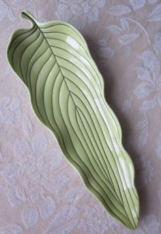 Use hosta leaves, support sides with rolled up newspaper or clay. Ruffle edges