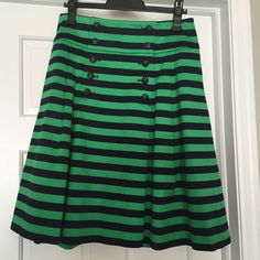 Gorgeous J.Crew sample striped sailor button skirt This skirt is amaaaazing and I can't figure out why they didn't produce it. It's a super luxurious weight cotton sateen, in perfect green and navy. Functional and adorable navy buttons. Fit is TTS. Included pic of sample label. I just haven't worn it, so I'm hoping to find it a good home! J. Crew Skirts