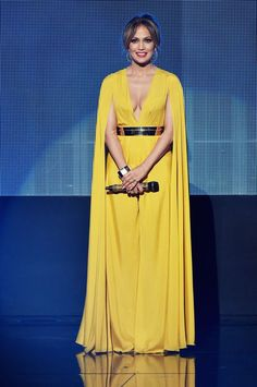 .in this sunflower yellow Michael Costello jumpsuit Jennifer Lopez Ropa, Jennifer Lopez Fotos, Jennifer Lopez Outfits, Michael Costello, American Music Awards 2015, Celebrity Red Carpet, Celebrity Style, Daily Fashion, Fashion News