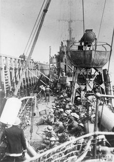 HMS Vanquisher, loading troops at low tide Dunkirk.
