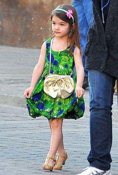 Suri Cruise...I want to dress my daughters like Suri, she's like a little doll!