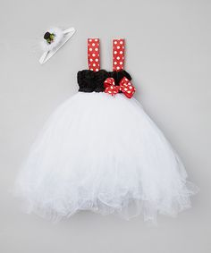 Little lovelies will adore the festive glow that this fantastical dress casts. This truly whimsical wardrobe addition boasts an easy-on fit, tons of tulle and a glimmering headband. It's perfect for the holidays.Includes dress and headbandHeadband: 14'' circumferenceHeadband embellishment: 4...