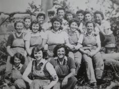 Lovely picture of a group of Land Girls in working dungarees.