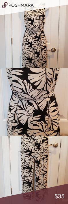 fa204132625bc Black and White Leaf Jumpsuit Sleeveless jumpsuit. Black with white leaf  print. High neckline