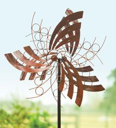 The metal Angel Wings Wind Spinner will add height and movement to your yard or garden. This large double wind spinner stands more than 6 feet tall with large feather-like details and circles that spin. Rich copper finish; three sturdy prongs stake it securely into the ground.