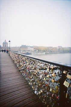 A bridge in Paris that couples use to attach a lock and then throw the keys into the water.