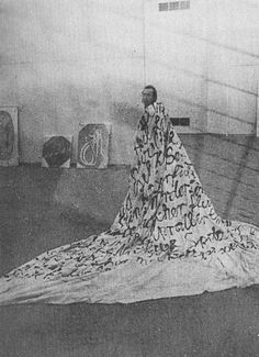 """Sigmar Polke ~ (1968) """"The Great Bitching Sheet"""" aka """"The Large Cloth of Abuse"""" (shown wearing it in 1976) Several flannel sheets stitched together, apx 13-by-14-foot, covered w German swear/insult words in black paint 