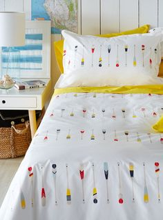 """Designed in our studios exclusively for Simons Maison     A popular summer pattern! Colourful paddles dip into the bedroom in a country club look inspired by waterside vacations and exclusive yacht clubs.      The set includes:   Twin: 1 duvet cover 66"""" x 90"""", 1 pillow sham 20"""" x 26""""  Double: 1 duvet cover 84"""" x 90"""", 2 pillow shams 20"""" x 26""""  Queen: 1 duvet cover 90"""" x 95"""", 2 pillow shams 20"""" x 29""""  King: 1 duvet cover 108"""" x 95"""", 2 pillow shams 20"""" x 36""""    *Home decor shown is for…"""