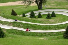 """""""Crystal Coaster Alpine Slide"""" at Crystal Mountain Resort in Michigan;  ride a sled down a 1,700 feet long curved track with dips and high-bank turns"""