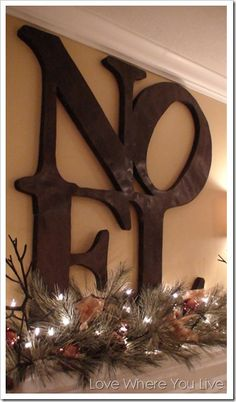 Adorable NOEL sign - could easily make one yourself using large letters from any craft store. Paint the color of your choice & glue together! Think how cute they'd be in red & white stripes! Check joann online for large letters. Christmas Mantels, Merry Little Christmas, Noel Christmas, Country Christmas, Winter Christmas, Christmas Crafts, Christmas Ideas, Christmas Letters, Christmas Fireplace
