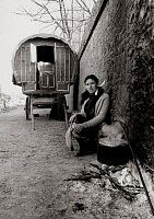 Irish Tinker Traveller woman cooking in front of her traditional bow caravan in Southern Ireland  1970's.