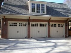 Carriage House Painted Garage Doors modern-garage-doors