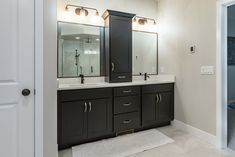 This master bathroom has sleek, clean lines and tons of room for 'his' and 'hers'!