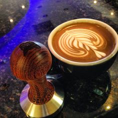 Perfect tulip made by Miguel Rivera (barista) from Puerto Rico. Latte art coffee intelligentsia coffee black cat project coffee tamper la marzocco