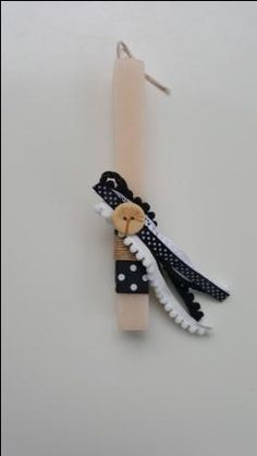 Handmade easter candle with wooden button, pom pon and cords