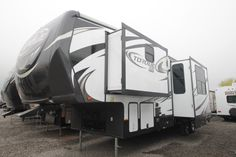 MASSIVE TOYHAULER!!!  2016 Heartland Torque TQ291 This RV has a 10' garage so you can bring fun toys on trips! A cozy bed to sleep in at night and an electric queen bed for guests. Sink into your sofa while eating or watching a movie after a long day. Bench seating also available in the garage. Chill outside under your awning and have fun for hours! Call our Torque expert Spencer England 435-774-0208