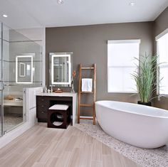 I like the texture under the tub vs the floor. IT can be tile not necessary wood.