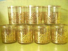 Set of 7- Vintage Gold embossed Glass Cups. $42.00, via Etsy.