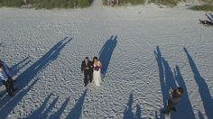 Only an aerial shot can show the shadows behind the bride and groom as they are walking down the aisle on this wedding at Honeymoon Island, Dunedin, FL http://celebrationsoftampabay.com/photographers-clearwater/