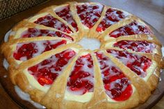 Cherry Cheese Coffee Cake    Cake & filling  2 8 oz. each pkgs refrigerated crescent rolls  8 ozcream cheese  1/4 cup powdered sugar  1 egg1/2 tsp vanilla or almond extract  21 oz can cherry pie filling  Glaze  1/2 cup powdered sugar  2-3 teaspoons milk