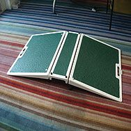 Bridge Folding Threshold Wheelchair Ramp  €542  Simple solution to the problem of a raised threshold strip. Folds out to produce a ramp on either side of a small platform, bridging the threshold strip and making it easy to go up, over and down the other side. Folds up neatly and comes with a carry handle for easy transportation