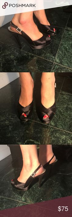 Satin Stuart Weitzman Heels These are gorgeous shoes! Black satin peep toe stilettos.  4.5 inch heel with a 1 inch platformed toe. Rhinestone buckle adds additional fun!  These have been worn several times, but still look great! Stuart Weitzman Shoes Heels