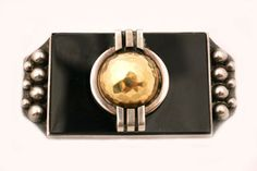 DESPRES GOLD, SILVER AND ONYX BROOCH ART DECO
